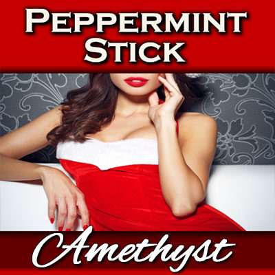 Underneath my sexy red velvet mini dress is a peppermint swirled strapon!
